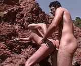 Téléchargement de Un couple exhib baise sur une plage en été
